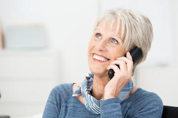 Woman on the phone | Dental Implants Sarasota FL
