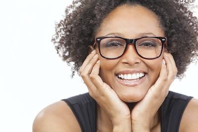Woman with glasses smiling | Sarasota Dentist