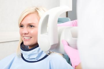 Woman getting dental xrays | Dentist Sarasota FL