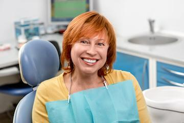 woman smiling in dental chair | Dentist Sarasota FL