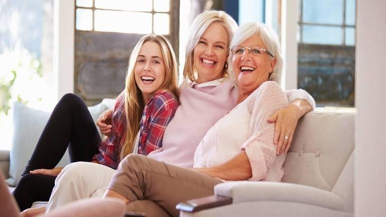 daughter, mother and granddaughter on couch | Sarasota Dentist
