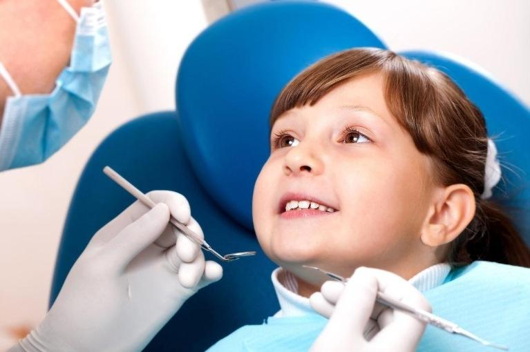 child in dental chair | dental exam sarasota fl